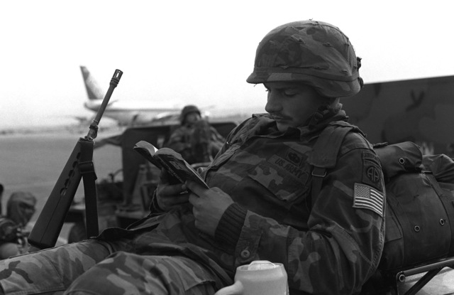 Private First Class Eric Horpe, 1ST Battalion, 319th Field Artillery, 82nd Airborne Division from Fort Bragg NC, reads as he waits for transportation home after his participation in the Autumn Forge Exercise CARBINE FORTRESS, a NATO exercise held annually in West Germany