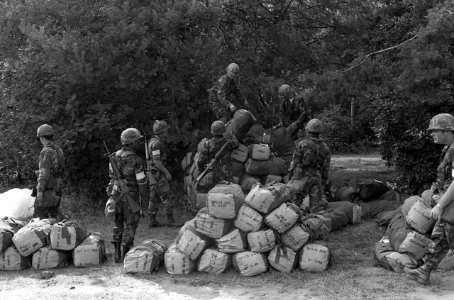 Soldiers of the 3rd Armored Cavalry Regiment, stack their personnel gear in their staging area. They are participating in Exercise Reforger-Carbine Fortress