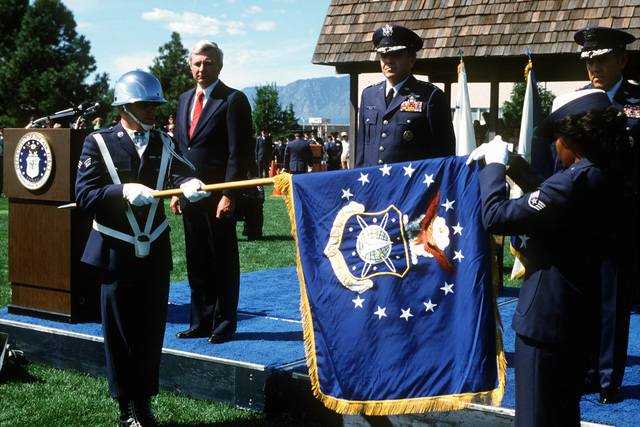 Standing at attention during the presentation to the Color Guard of the new Space Command flag are (from left to right), Under Secretary of the Air Force Edweard C. Aldridge Jr., Air Force Vice-CHIEF of STAFF GEN Jerome E. O'Malley, and GEN James V. Hartinger, the first commander of the newly formed Space Command