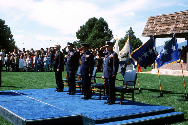 Standing at attention while reviewing the color guard during the dedication ceremony for Space Command are (from left to right), Under Secretary of the Air Force Edweard C. Aldridge Jr., Air Force Vice-CHIEF of STAFF GEN Jerome E. O'Malley, and GEN James V. Hartinger, the first commander of the newly formed Space Command