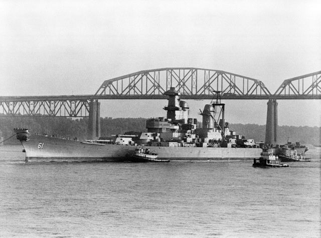 The battleship USS IOWA (BB 61) passes under the Huey P. Long Bridge after a 1833 mile journey to Avondale Shipyards Inc. from the Philadelphia Naval Shipyard for modernization and reactivation