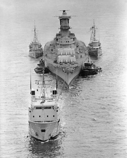 The fleet tug USNS APACHE (T ATF 172) tows the battleship USS IOWA (BB 61) from the Philadelphia Naval Shipyard