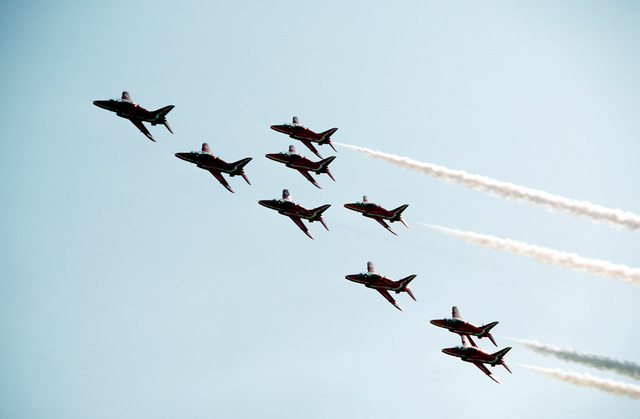 The Royal Air Force Red Arrows aerial demonstration team performs at the Farnborough Air Show. They are flying Hawk T. aircraft