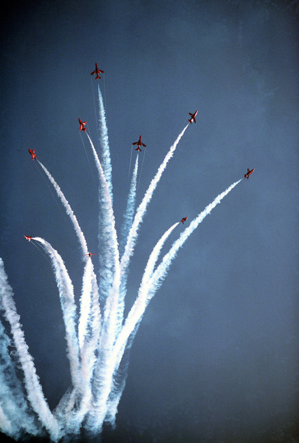 The Royal Air Force Red Arrows aerial demonstration team performs at the Farnborough Air Show