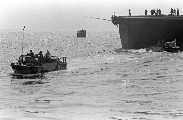 Two U.S. Marine lighter amphibious resupply cargo vehicles (LARC-V) leave the amphibious transport dock USS NASHVILLE (LPD-13). U.S. Marines have been assigned to Lebanon as part of the multinational peacekeeping force following a confrontation between Israeli forces and the Palestine Liberation Organization