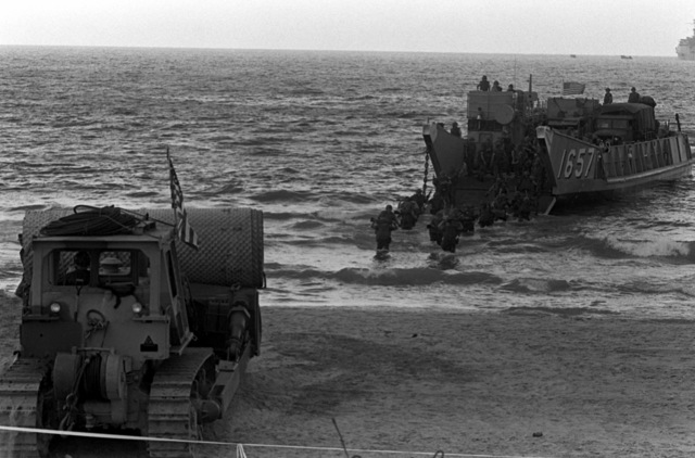 U. S. Marines disembark from utility landing craft 1657 (LCU-1657). U.S. Marines have been assigned to Lebanon as part of a multinational peacekeeping force after a confrontation between Israeli forces and the Palestine Liberation Organization