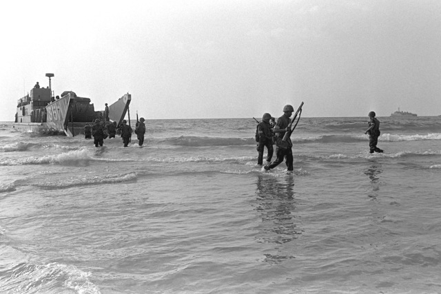 U.S. Marines come ashore during landing operations. U.S. Marines have been assigned to Lebanon as part of a multinational peacekeeping force following a confrontation between Israeli forces and the Palestine Liberation Organization
