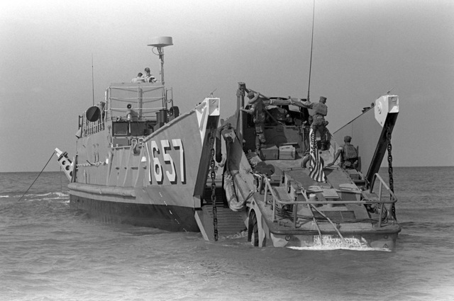 U.S. Marines drive a lighter amphibious resupply cargo vehicle (LARC-V) aboard utility landing craft 1657 (LCU-1657). U.S. Marines have been assigned to Lebanon as part of a multinational peacekeeping force after a confrontation between Israeli forces and the Palestine Liberation Organization