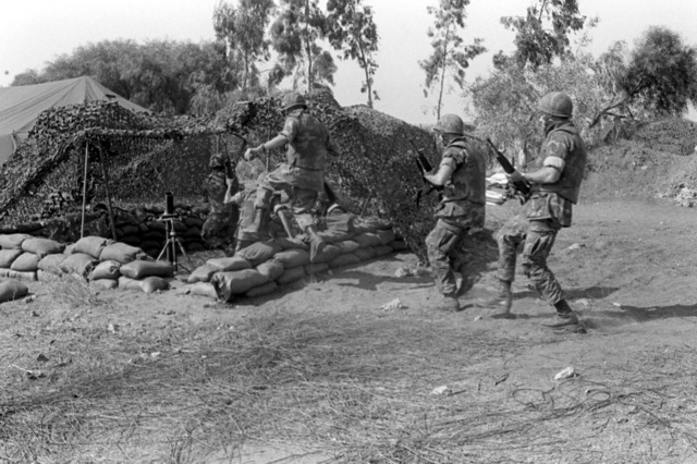 U.S. Marines from an 81mm unit run to their mortar at the start of a general quarters drill. U.S. Marines have been assigned to Lebanon as part of a multinational peacekeeping force following a confrontation between Israeli forces and the Palestine Liberation Organization