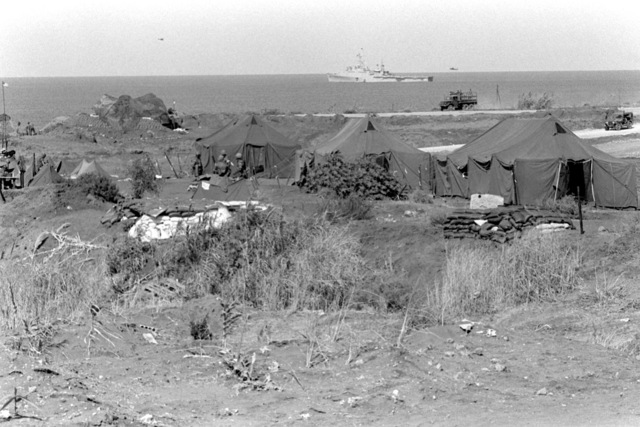U.S. Marines from Company F establish their camp near the beach. U.S. Marines have been assigned to Lebanon as part of a multinational peacekeeping force following a confrontation between Israeli forces and the Palestine Liberation Organization