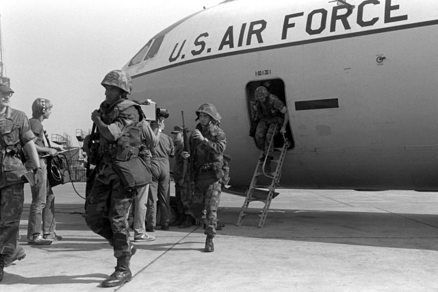 U.S. Marines leave a U.S. Air Force C-141B Starlifter aircraft. U.S. Marines have been assigned to Lebanon as part of a multinational peacekeeping force following a confrontation between Israeli forces and the Palestine Liberation Organization