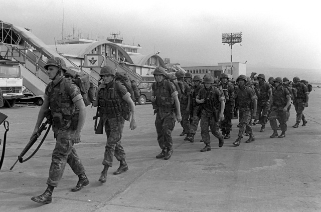 U.S. Marines march across the runway apron of Beirut International Airport upon their arrival. The Marines have been assigned to Lebanon as part of the multinational peacekeeping force following a confrontation between Israeli forces and the Palestine Liberation Organization