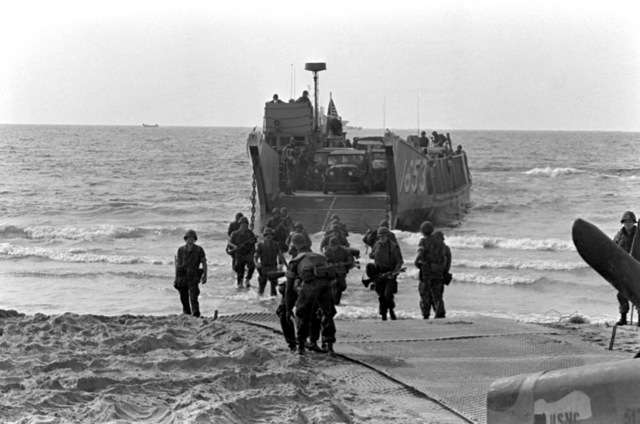 U.S. Marines prepare to offload equipment and supplies from utility landing craft 1653 (LCU-1653) during landing operations. U.S. Marines have been assigned to Lebanon as part of a multinational peacekeeping force following a confrontation between Israeli forces and the Palestine Liberation Organization