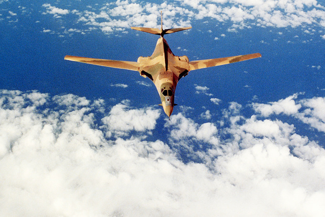 An air-to-air front view of a B-1 bomber aircraft on a demonstration flight during the Farnborough Air Show