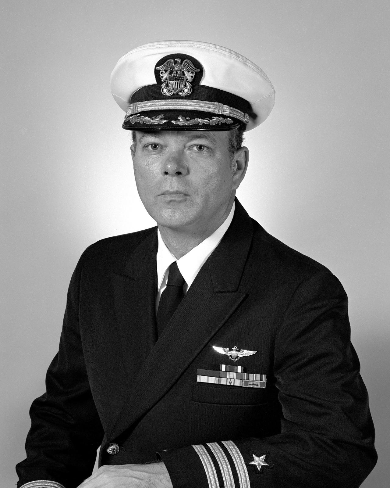 Commander James L. Crum, USN (covered)