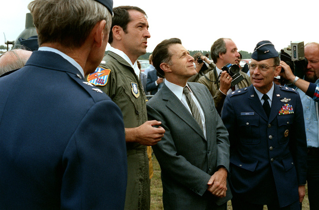 Secretary of Defense Caspar Weinberger observes a demonstration flight of a B-1 bomber aircraft during his visit to the Farnborough Air Show