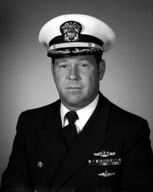 CMDR John W. Clinton, USN (covered)