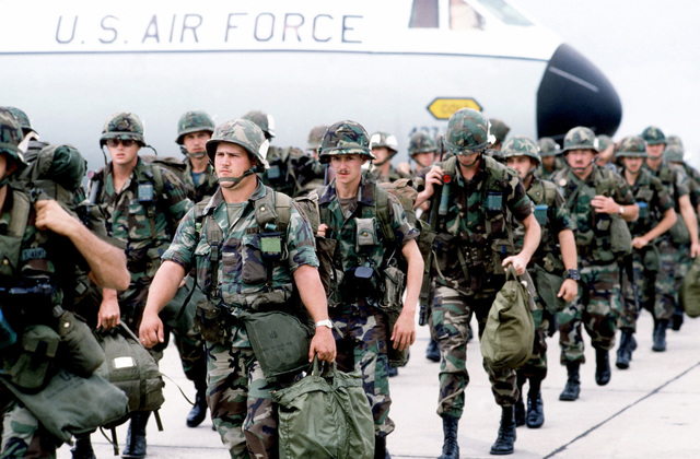Members of the 1ST Battalion, 4th Cavalry, march from a C-141B Starlifter aircraft to a briefing area, prior to their redeployment by bus to Nahobllebach to participate in Reforger '82