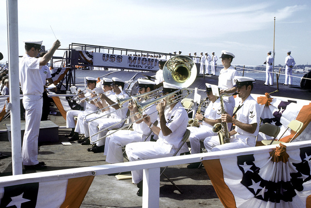 The U.S. Navy Northeastern Band plays during the commissioning ceremony for the nuclear-powered strategic missile submarine USS MICHIGAN (SSBN-727)