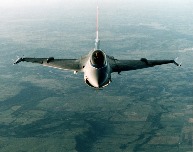 An air-to-air top front view of an F-16XL Fighting Falcon prototype aircraft armed with AIM-9 Sidewinder missiles on each wing tip and AIM-7 Sparrow missiles on the undercarriage