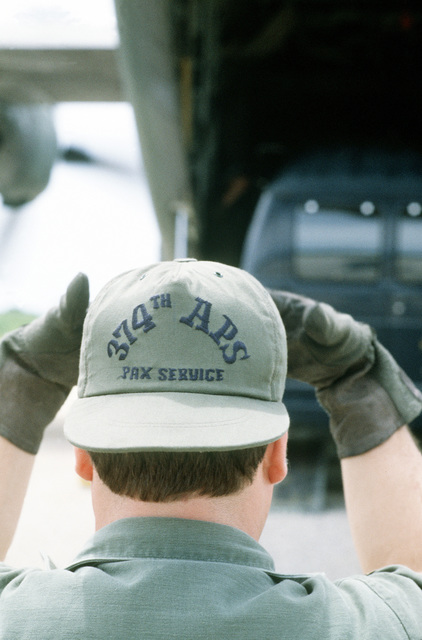 SRA Robert Bennet from the 316th Organizational Maintenance Squadron, directs the unloading of a C-130 Hercules aircraft during Exercise Kennel Bear '4-82