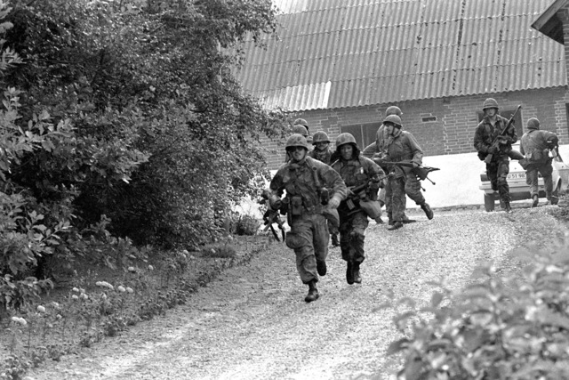 Members of the 4th Marine Amphibious Brigade run to get into position during Operation Northern Wedding '82