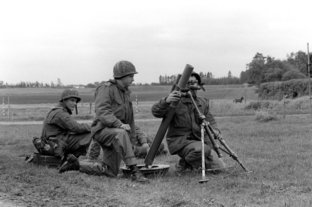 "Men from the 4th Marine Amphibious Brigade simulate bombardment of the ""enemy"" position with an M-29A1 81mm mortar during Operation Northern Wedding '82"
