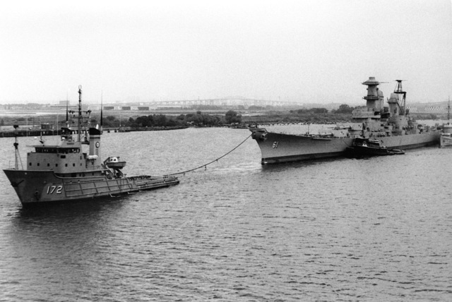 Port bow view of the battleship IOWA (BB-61) being towed by the Military Sealift Command oceangoing tug USNS APACHE (T-ATF-172). The IOWA, towed from Philadelphia Navy Yard, will be reactivated and modernized at Avondale Shipyard and Ingalls Shipbuilding prior to recommissioning