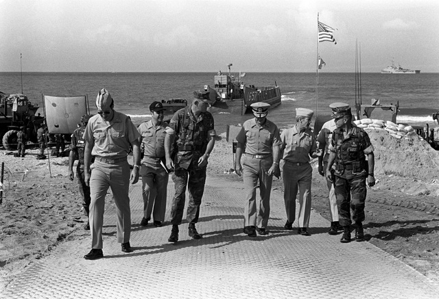 Colonel James M. Meade (left center), 32nd Marine Amphibious Unit Commander, walks up the beach with Vice Admiral J. R. Hogg, Seventh Fleet, Commander, and Rear Admiral Ed Martin, Sixth Fleet Commander, as they arrive to observe the multinational peacekeeping operation
