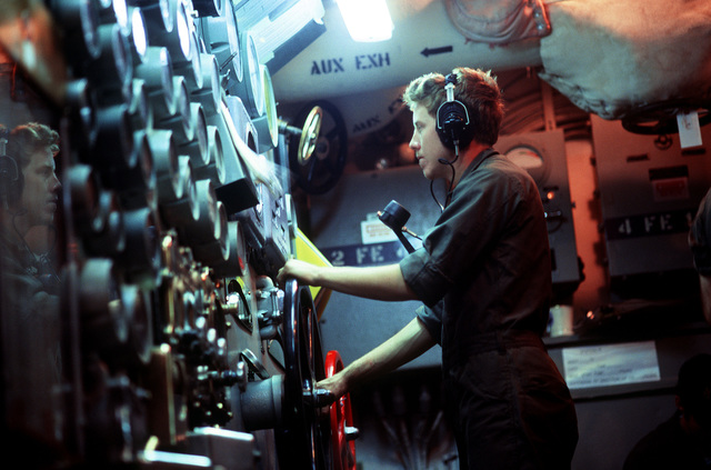 A crewman monitors the engine room control panel aboard the USS NEW JERSEY (BB 62). The battleship, after recently completing renovation and modernization, is undergoing sea trials prior to reactivated in January 1983