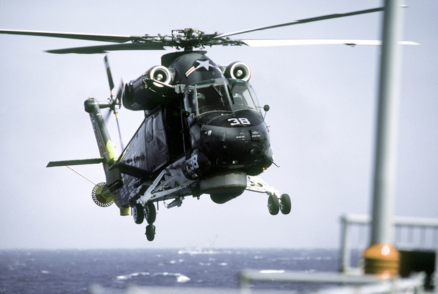 A right front view of a Navy SH-2F light airborne multi-purpose system (LAMPS) helicopter landing aboard the battleship USS NEW JERSEY (BB-62) during sea trials