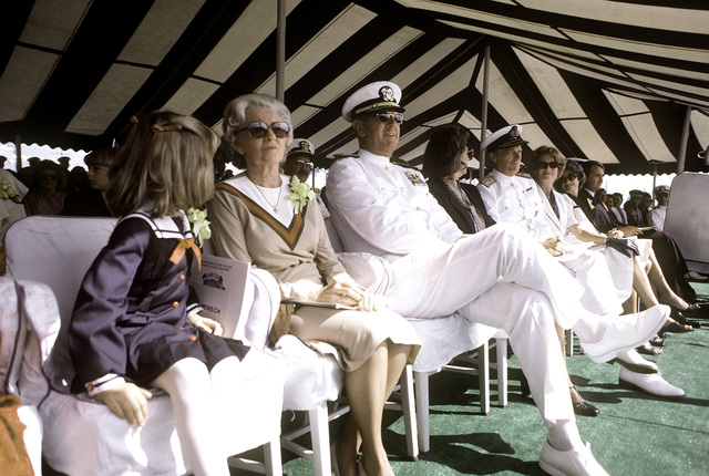 A side view of some of the honored guests (two rear admirals and their families) as they listen to the different speakers during the commissioning ceremony for the nuclear-powered attack submarine USS HOUSTON (SSN-713)