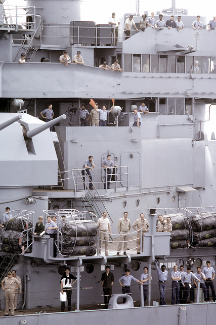 A view of a crew aboard the battleship USS NEW JERSEY (BB-62) leaving for sea trials