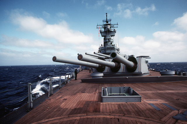 A view of the 16-inch/50-caliber guns on the forward deck of the battleship USS NEW JERSEY (BB 62). The NEW JERSEY, after recently completing renovation and modernization, is undergoing sea trials prior to reactivation in January 1983