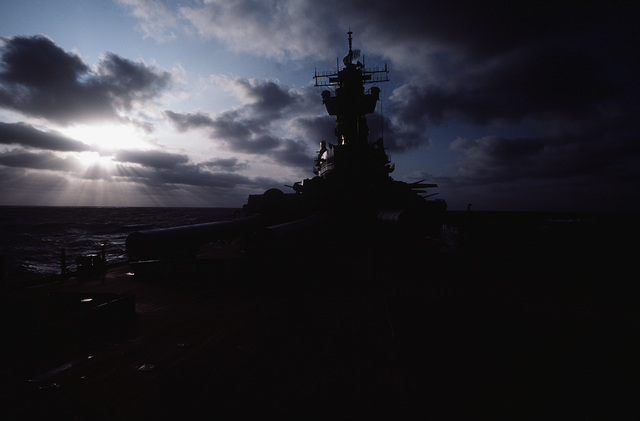 A view of the sunset as seen from the deck of the battleship USS NEW JERSEY (BB 62). The NEW JERSEY, after recently completing renovation and modernization, is undergoing sea trials prior to reactivated in January 1983