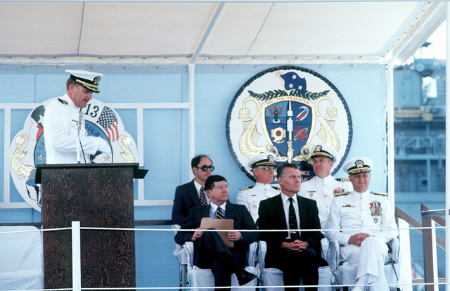 CAPT G.H. Mensch, commanding officer, nuclear-powered attack submarine USS HOUSTON (SSN-713), prepares to speak during the ship's commissioning ceremony. To his left are Sen. John G. Tower, R-Texas; G.A. Sawyer, assistant secretary of the Navy; and VADM Steven A. White, commander, Submarine Force, U.S. Atlantic Fleet