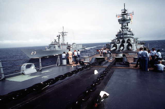 Crewmen aboard the battleship USS NEW JERSEY (BB 62) watch as the guided missile frigate USS LEWIS B. PULLER (FFG 23) comes alongside. The NEW JERSEY, after recently completing renovation and modernization, is undergoing sea trials prior to reactivation in January 1983