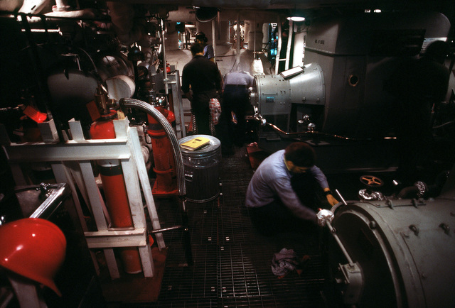 Crewmen operate the electrical generators in the upper level engine room aboard the USS NEW JERSEY (BB 62). The NEW JERSEY, after recently completing renovation and modernization, is undergoing sea trials prior to reactivated in January 1983