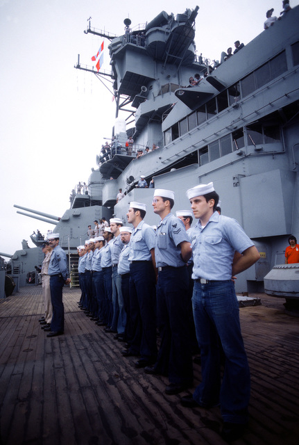 Crewmen stand in formation, at parade rest, on the deck of the battleship USS NEW JERSEY (BB 62). The NEW JERSEY, after recently completing renovation and modernization, is undergoing sea trials prior to reactivation in January 1983