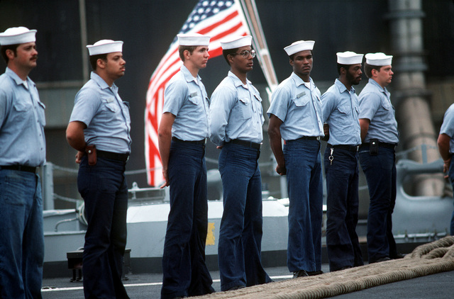 Crewmen stand in formation on the deck of the battleship USS NEW JERSEY (BB 62). The NEW JERSEY, after recently completing renovation and modernization, is departing for sea trials prior to reactivation in January 1983