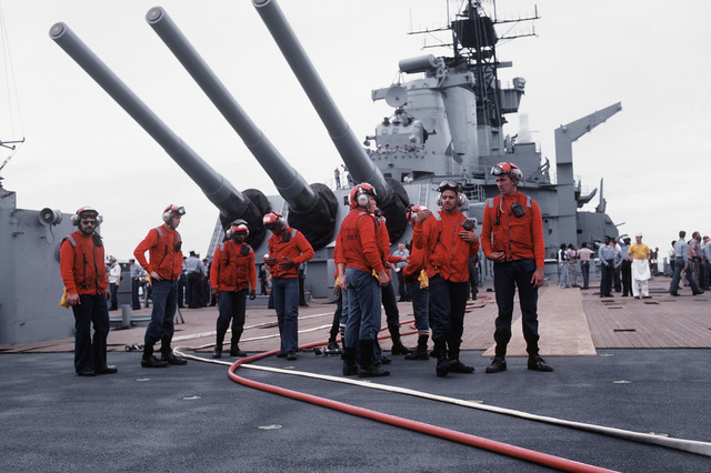 Deck crewmen prepare for the firing of a 16-inch/50-caliber guns aboard the battleship USS NEW JERSEY (BB 62). The NEW JERSEY, after recently completing renovation and modernization, is undergoing sea trials prior to reactivation in January 1983
