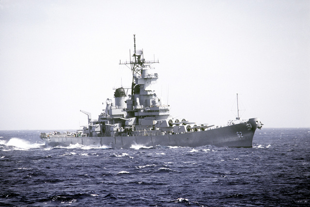 Starboard bow view of the battleship USS NEW JERSEY (BB-62) during sea trials