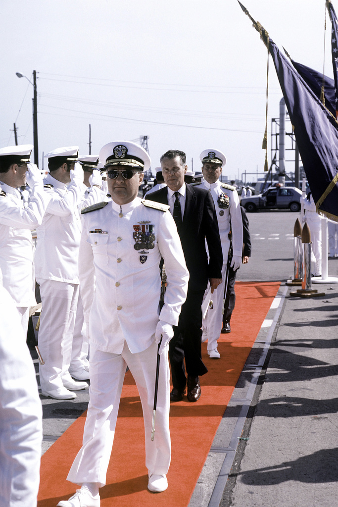 VADM Steven A. White, commander, Submarine Force, U.S. Atlantic Fleet, comes aboard the nuclear-powered attack submarine USS HOUSTON (SSN-713) during the ship's commissioning ceremony
