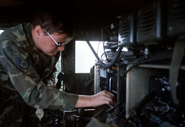 A forward air controller operates a radio used to direct an F-4 Phantom II aircraft a bomb target. The controller is from the 22nd Tactical Air Support Squadron and is involved in Exercise Opportune Journey 4