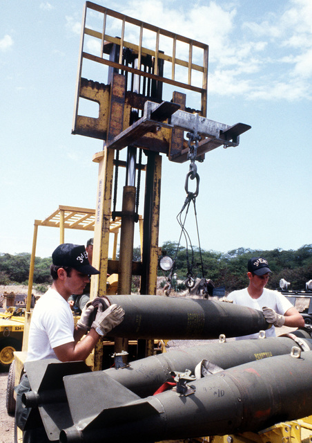 Members of the 3rd Munitions Maintenance Squadron load Mark 82 500-pound laser-guided bomb shells onto a bomb cart during Exercise Opportune Journey 4