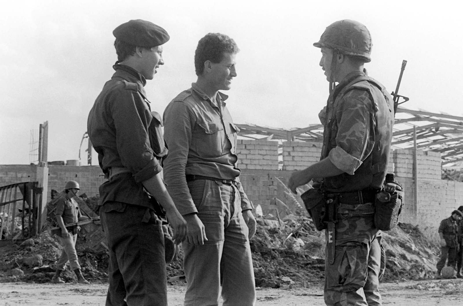 A Marine talks with a Lebanese Armed Forces soldier (center) and a