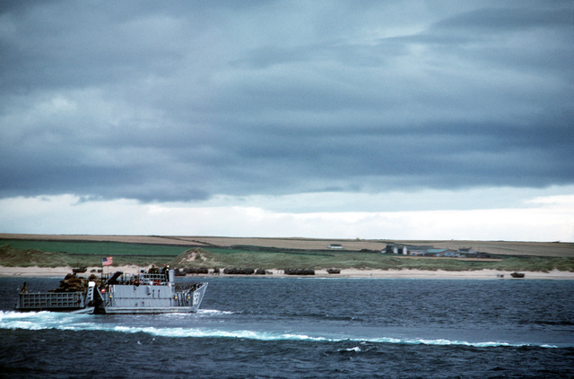 A Navy utility landing craft approaches the beach during the NATO Exercise NORTHERN WEDDING '82
