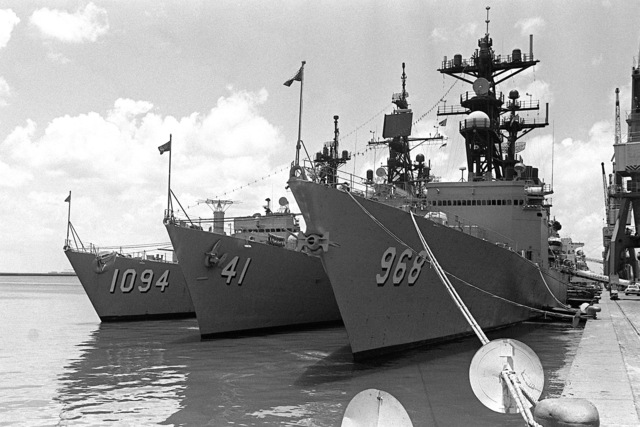 A port bow view of the Unitas XXI ships in port during the exercise. From left to right, the frigate USS PHARRIS (FF-1094), the guided missile destroyer USS KING (DDG-41) and the destroyer USS ARTHUR W. RADFORD (DDG-968)