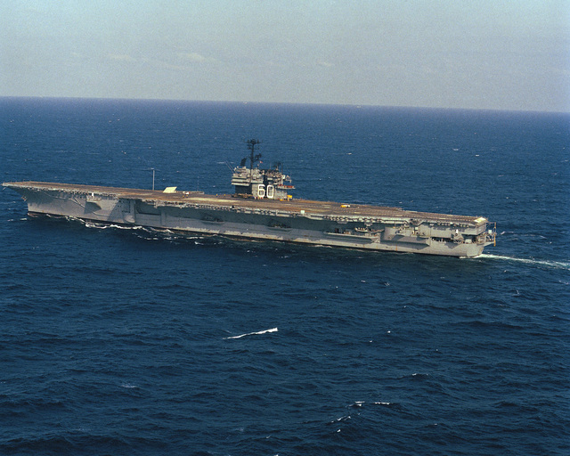 A port quarter view of the aircraft carrier USS SARATOGA (CV 60) underway