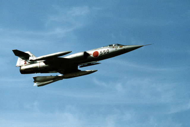 A right side view of an F-104 Starfighter aircraft in flight during training exercise Cope North '83-1. The F-104 belongs to a unit of the Japanese Air Self Defense Force stationed at Chitose Air Base